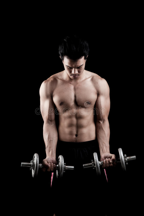Muscular Asian man with dumbbell stock images