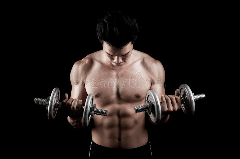 Muscular Asian man with dumbbell stock photos