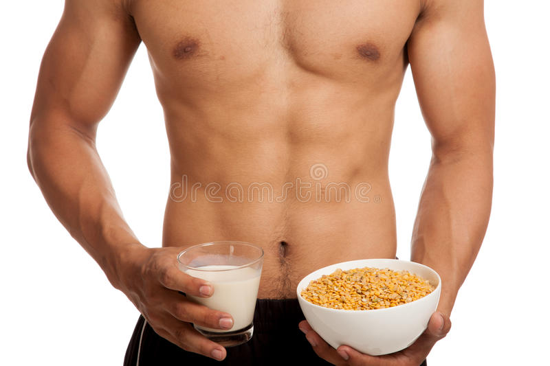 Muscular Asian man with soybeans and soy milk stock photo