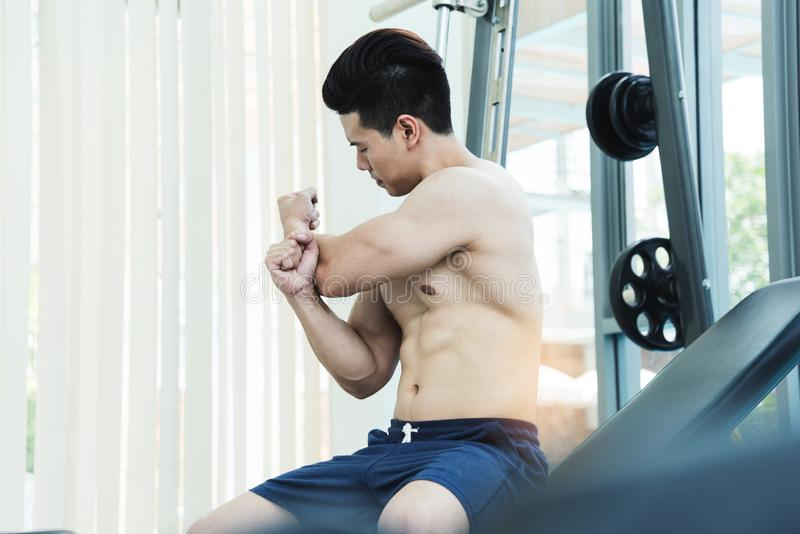 Muscular Asian man Stretching before workout royalty free stock photography