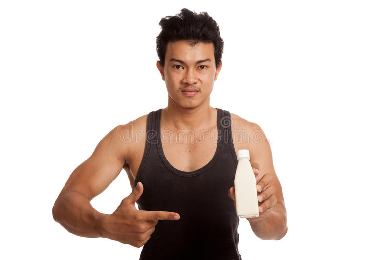Muscular Asian man thumbs up point to soy milk royalty free stock image