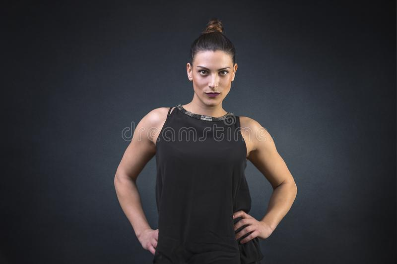 Muscular and Attractive young woman, showing off her strong build muscular body dressed for a night out royalty free stock photos