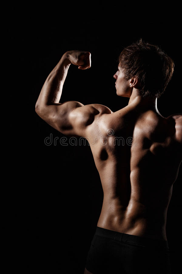 Muscular BACK of male model bodybuilder preparing for fitness tr royalty free stock photography