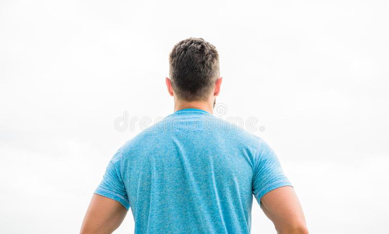 Muscular back man isolated on white. dreaming about future life. looking far in the future. thinking about possibilities. Looking up on white background royalty free stock images