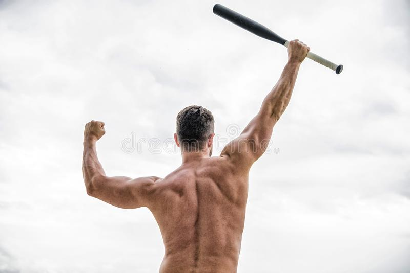 Muscular back man isolated on white. man with baseball bat. i am a criminal. Hooligan man hits the bat. Bandit gang and. Conflict. full of energy. sport royalty free stock image