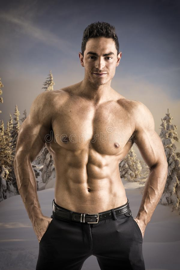 Muscular bare-chested man stock photos