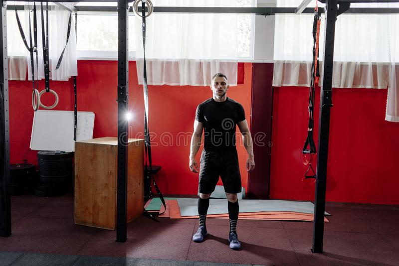 Muscular bearded man preparing to training his biceps and back. royalty free stock photo