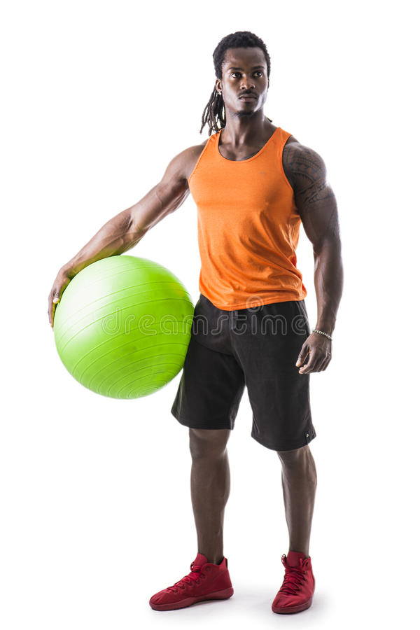 Muscular black man holding inflatable fitness ball. Looking at camera, standing isolated on white background stock photography