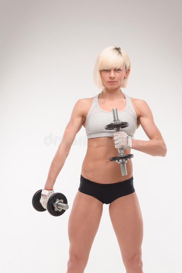Muscular body of a young girl stock image