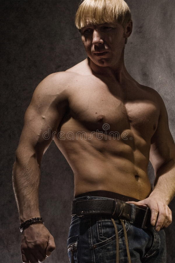 Muscular bodybuilder. Hree quarter body portrait of muscular young bodybuilder with bare torso stock images