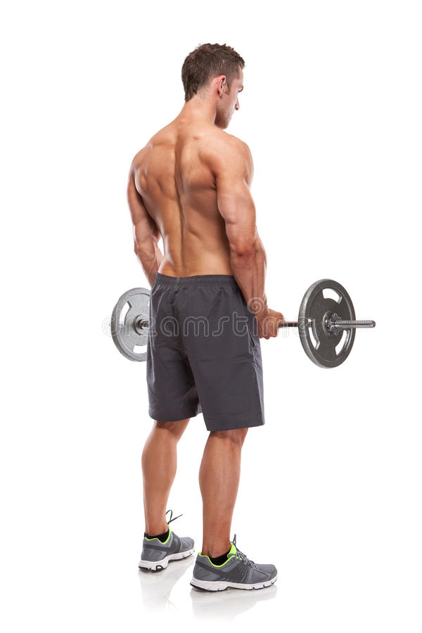 Muscular bodybuilder guy doing exercises with big dumbbell over stock photo