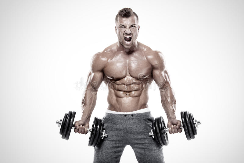 Muscular bodybuilder guy doing exercises with dumbbell. Over white background stock photo