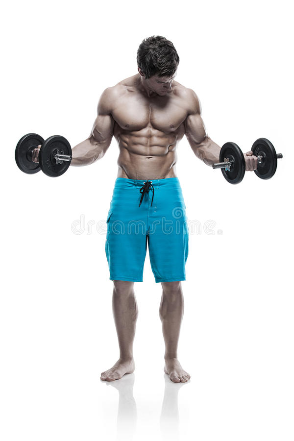Muscular bodybuilder guy doing exercises with dumbbells over white background royalty free stock photography