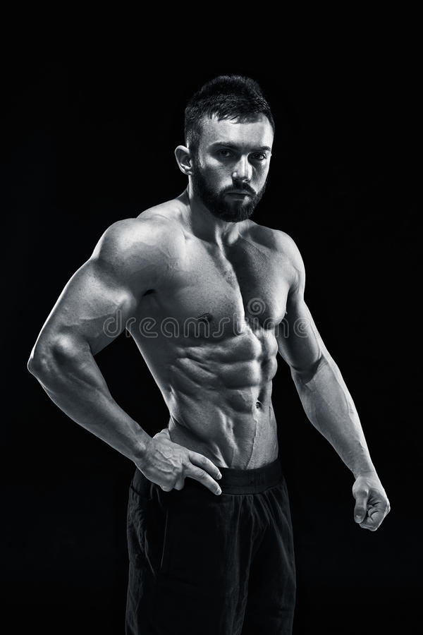 Muscular bodybuilder guy doing posing royalty free stock photography