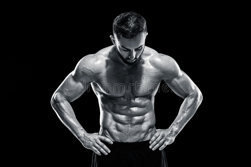 Muscular bodybuilder guy doing posing stock image