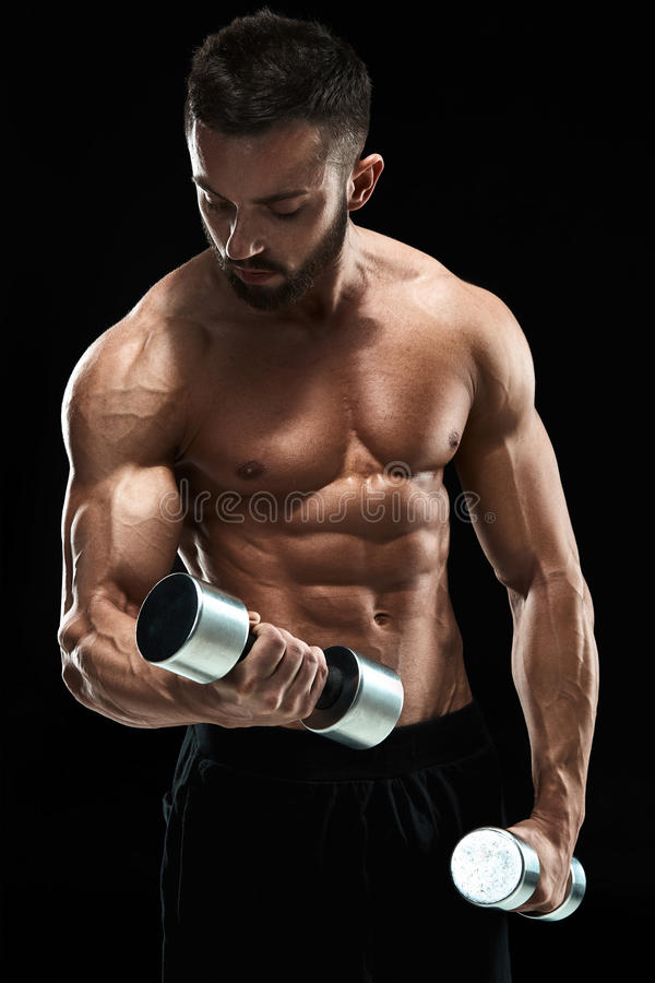 Muscular bodybuilder guy doing posing stock images