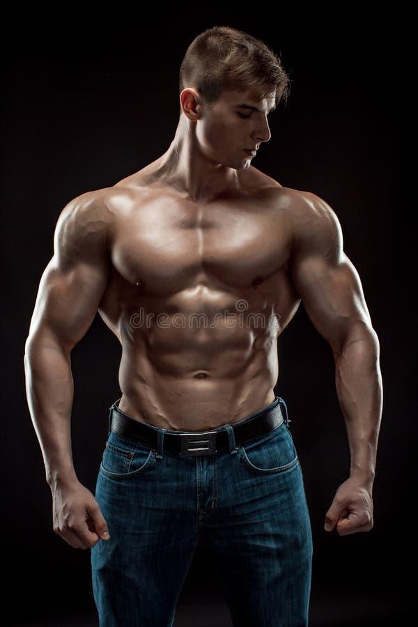 Sexy guy posing in studio — Stock Photo © ALotOfPeople