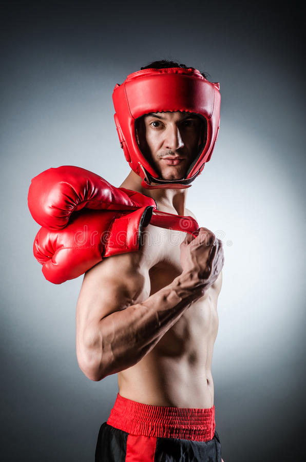 Muscular boxer. Wiith red gloves royalty free stock photo