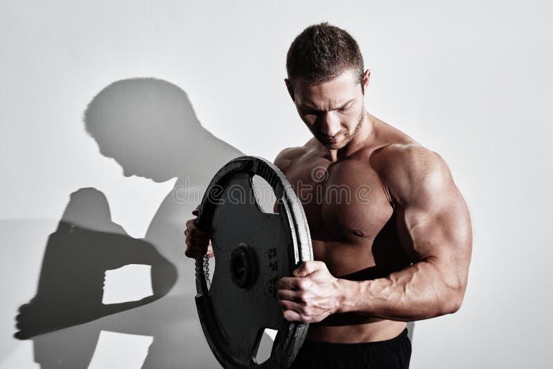 Strong Muscular Bodybuilder Athlete Man Posing And Pumping