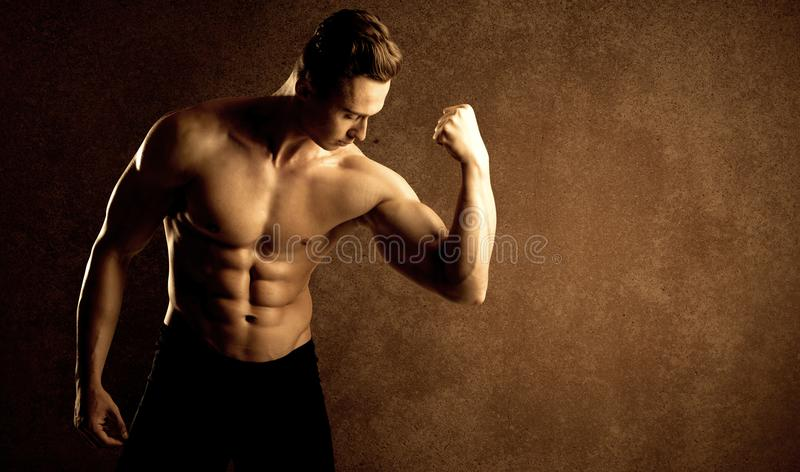 Muscular fit bodybuilder athlete lifting weight stock images