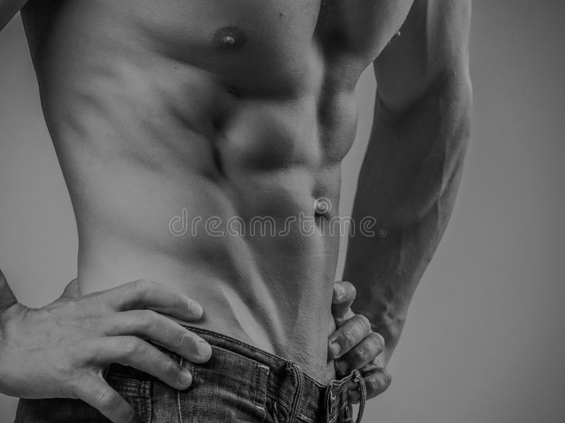 Perfectly fit shirtless young man stock photo