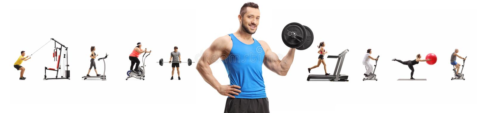 Muscular guy lifting weights and many people exercising in the background royalty free stock images