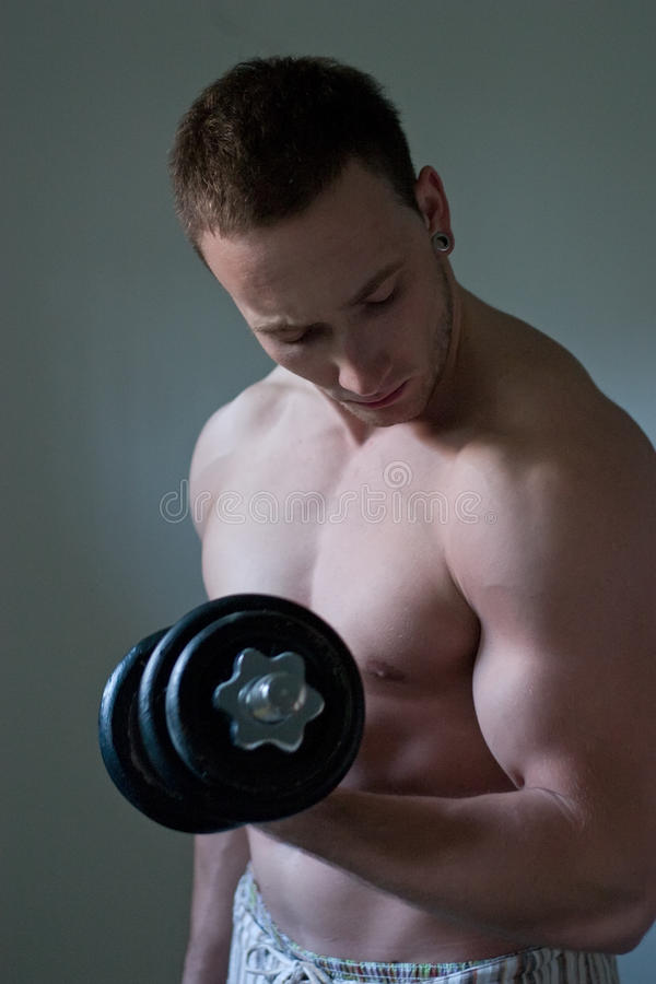 Muscular guy workout royalty free stock photography