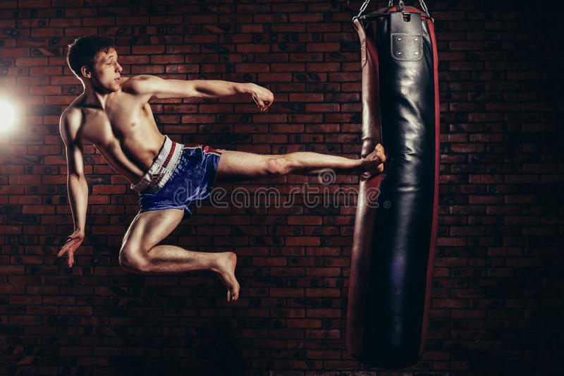 Muscular handsome fighter giving a forceful stock photo