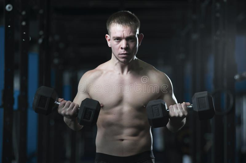 Athletic Shirtless Man Showing Well Trained Body. stock image