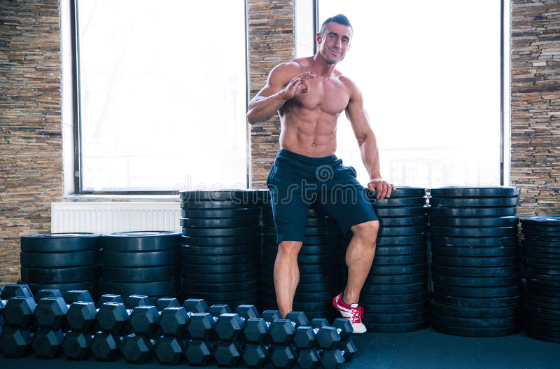 Muscular happy man showing ok sign stock images