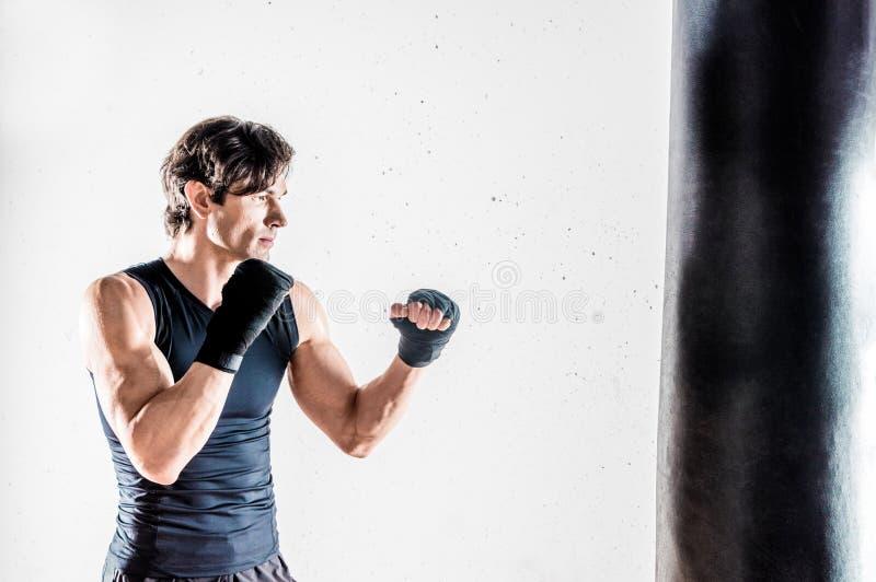 Muscular kickbox fighter stock photo
