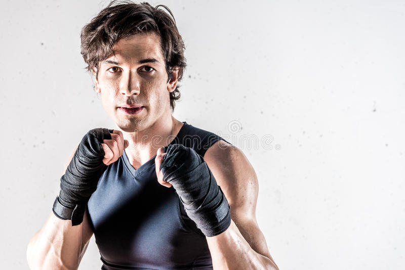 Muscular kickbox fighter royalty free stock image