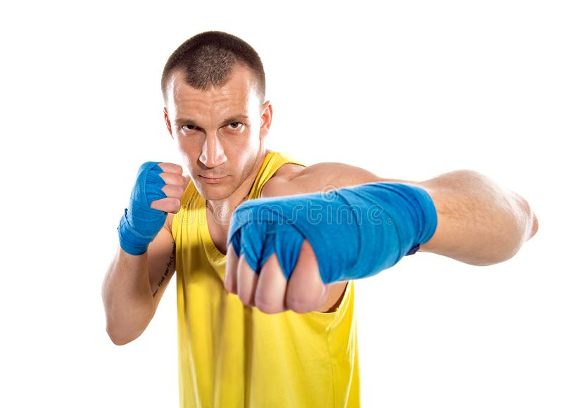 Muscular kickbox or muay thai fighter punching, isolated on white background. Ukrainian fighter. Ukraine. Blue, Yellow.  royalty free stock image