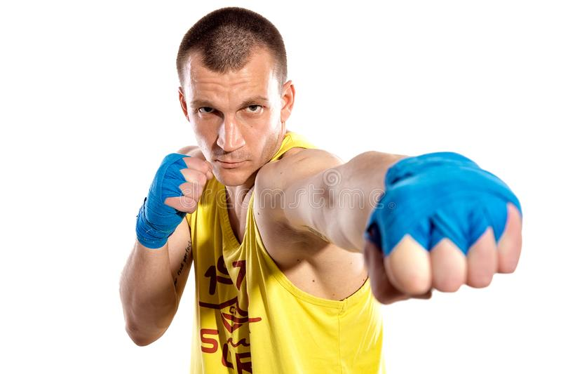 Muscular kickbox or muay thai fighter punching, isolated on white background. Ukrainian fighter. Ukraine. Blue, Yellow stock photo