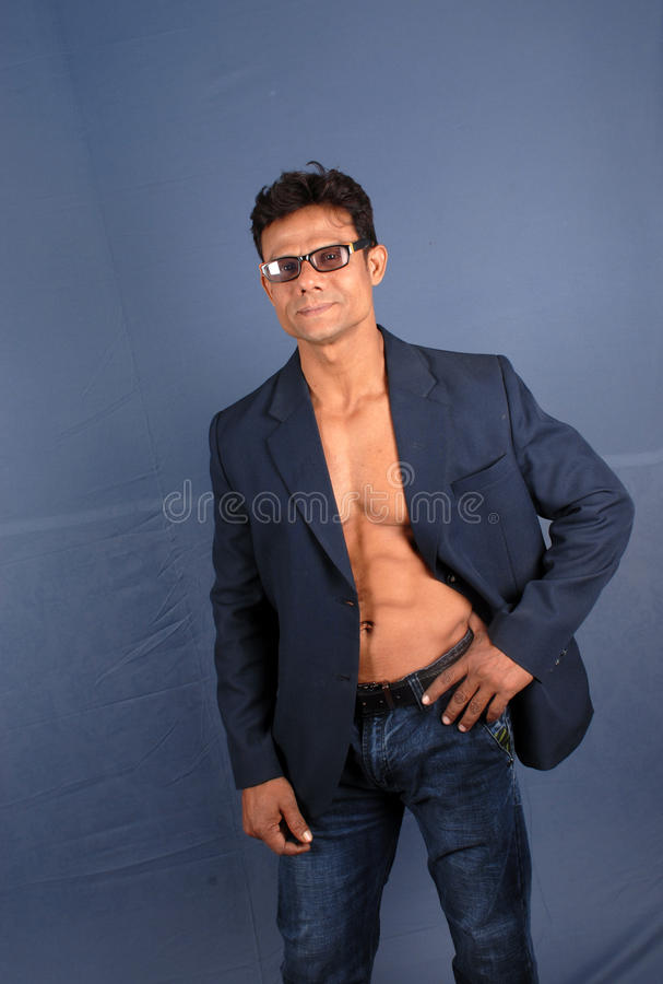 Muscular Male in Blazer. Muscular male wearing a suit jacket showing his bare chest stock images
