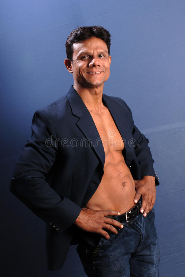 Muscular Male in Blazer. Muscular male wearing a suit jacket showing his bare chest stock photos
