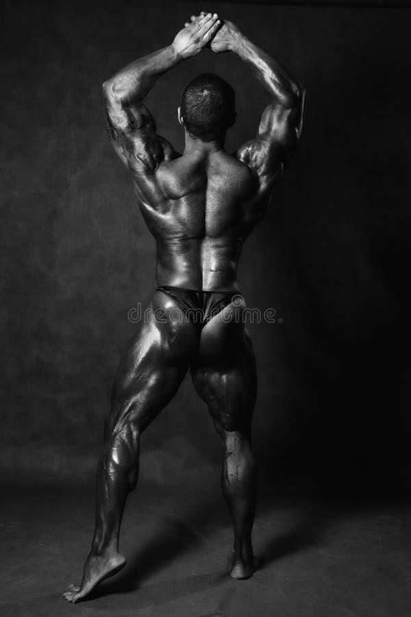 Muscular male Bodybuilder posing in studio stock photos