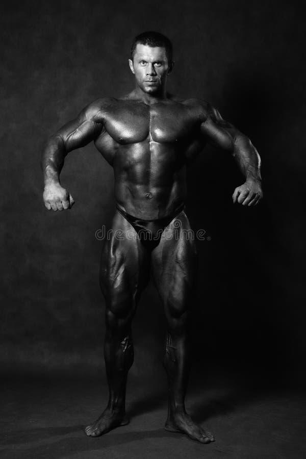 Muscular male Bodybuilder posing royalty free stock photos