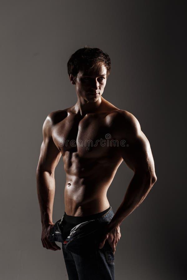 Muscular male model bodybuilder before training. Studio shot on stock image