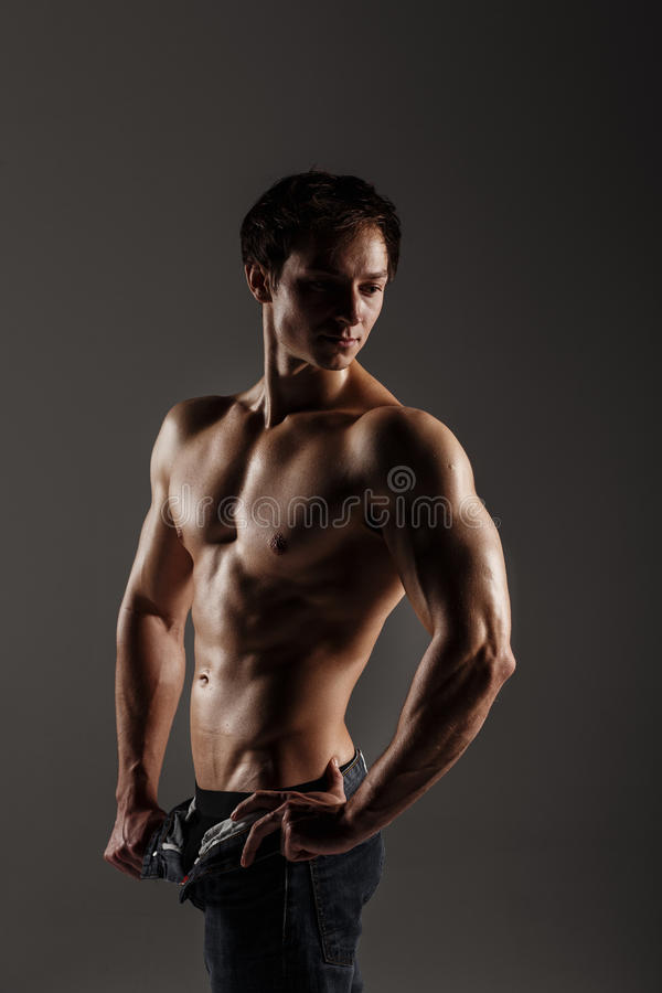 Muscular male model bodybuilder before training. Studio shot on royalty free stock image