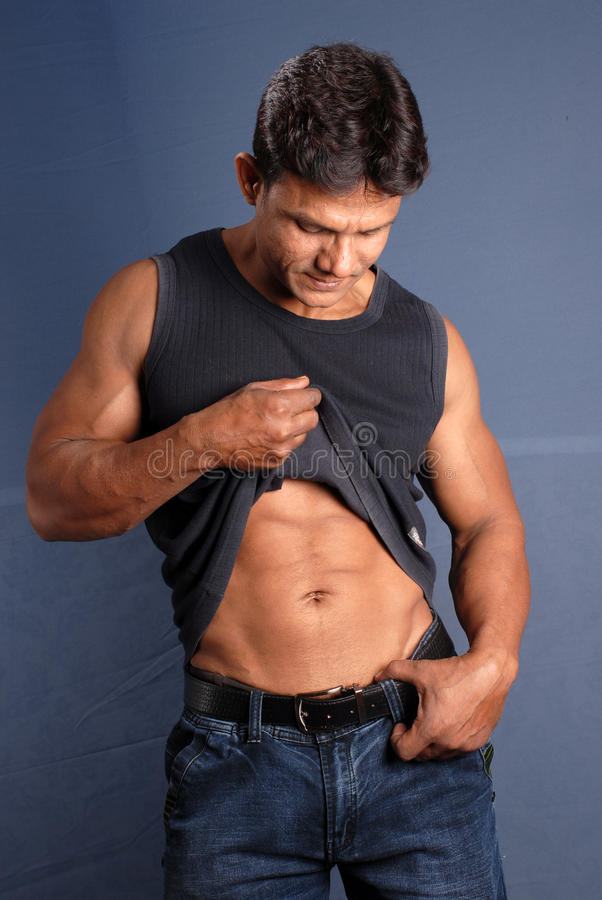 Muscular Male. Showing his belly royalty free stock photo