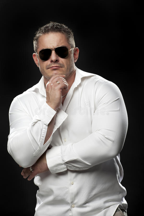 Muscular male in a white shirt posing