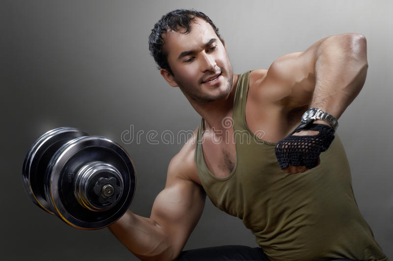 Muscular man. Powerful muscular man lifting weights stock photos