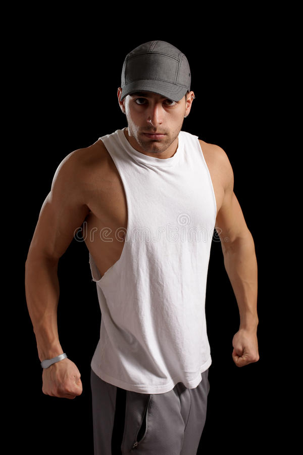 Muscular Man. Muscular young man. Studio shot over black stock photos