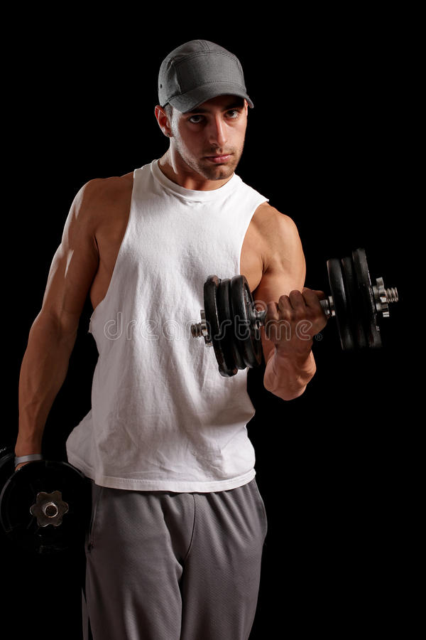 Muscular Man. Muscular young man. Studio shot over black stock photography