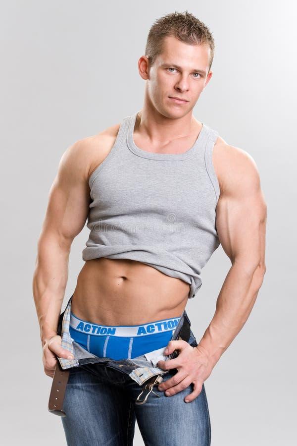Muscular man. A muscular young man posing stock photography
