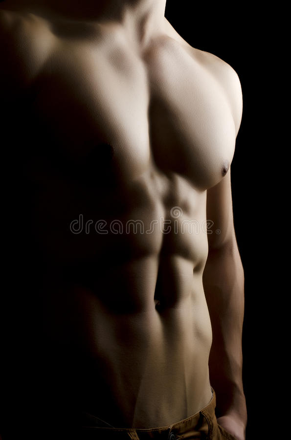 Muscular man body on black background royalty free stock photos