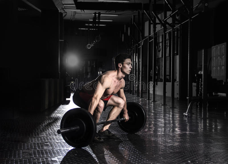 Muscular man doing the crossfit exercise in the gym.Preparing to stock photos
