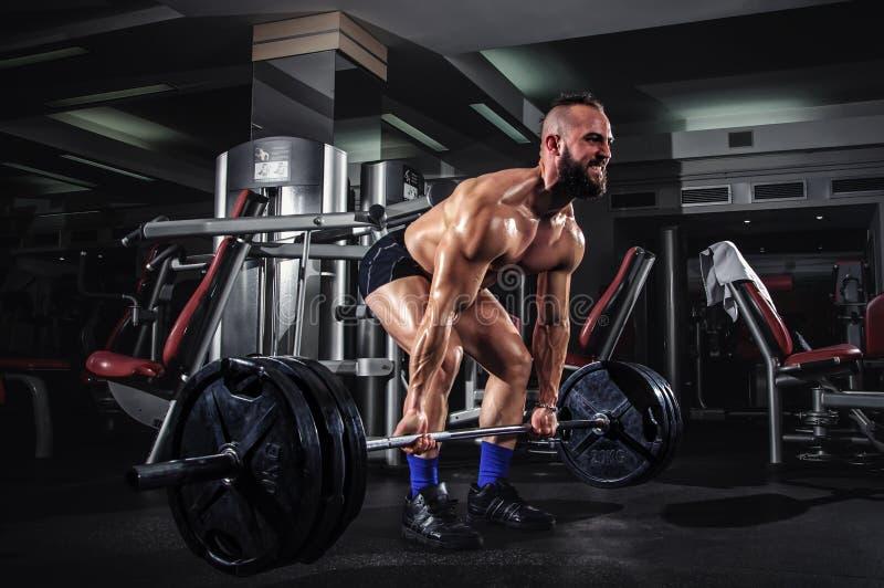 Muscular Man Doing Heavy Deadlift Exercise stock images