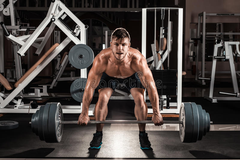 Muscular Man Doing Heavy Deadlift Exercise royalty free stock photography